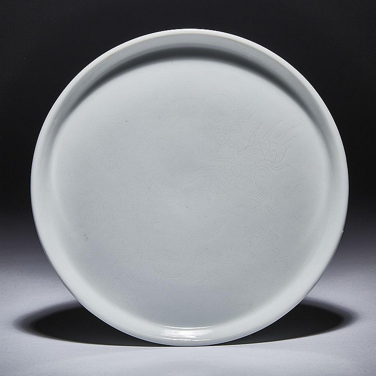 An Anhua Phoenix White- Glazed Shallow Dish, Tian Mark, Qing Dynasty, diameter 9.2