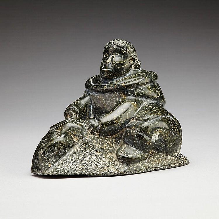 SARAH NASTAPOKA (1925-), WOMAN SKINNING A SEAL, stone, 7.5