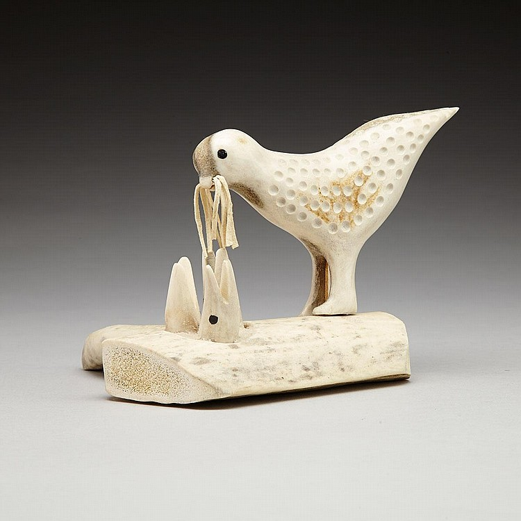 NOAH ANNANACK (1937-), BIRD FEEDING ITS HATCHLINGS, antler, skin, baleen, 5