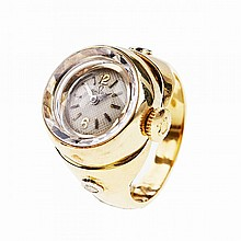 Lady's Omega Ring Watch, 17 jewel movement; in a 18k and 14k yellow gold case set with 2 small brilliant cut diamonds
