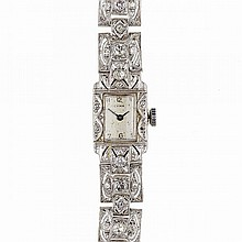 Lady's Cyma Wristwatch, 17 jewel movement; in a platinum filigree case and integral strap set with a total of 53 single cut diamonds (approx. 1.50ct.t.w.)