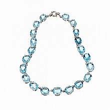 Italian 14k White Gold Necklace, set with 21 graduated oval cut blue topaz