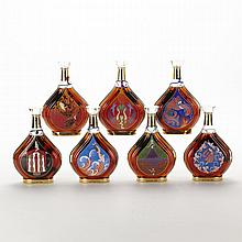 COURVOISIER ERTÉ COLLECTION (BTS 1-7) The Erté Courvoisier Collection consists of seven limited edition bottles, each illustrating one stage in the cognac-making process. The bottles were designed by Erté, a Russian illlustrator who was well known