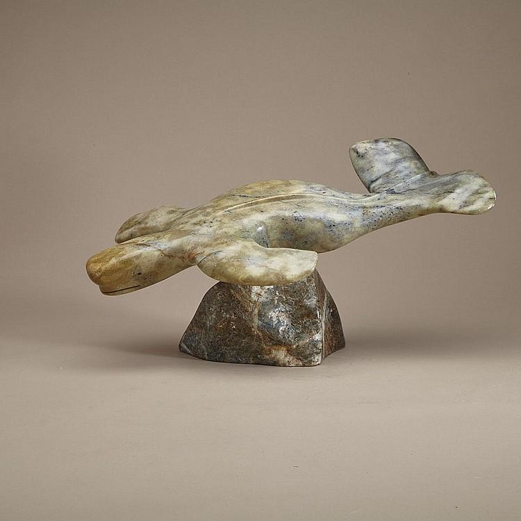 FLOYD KUPTANA (1964-), SWIMMING WHALE ON BASE, stone, 10