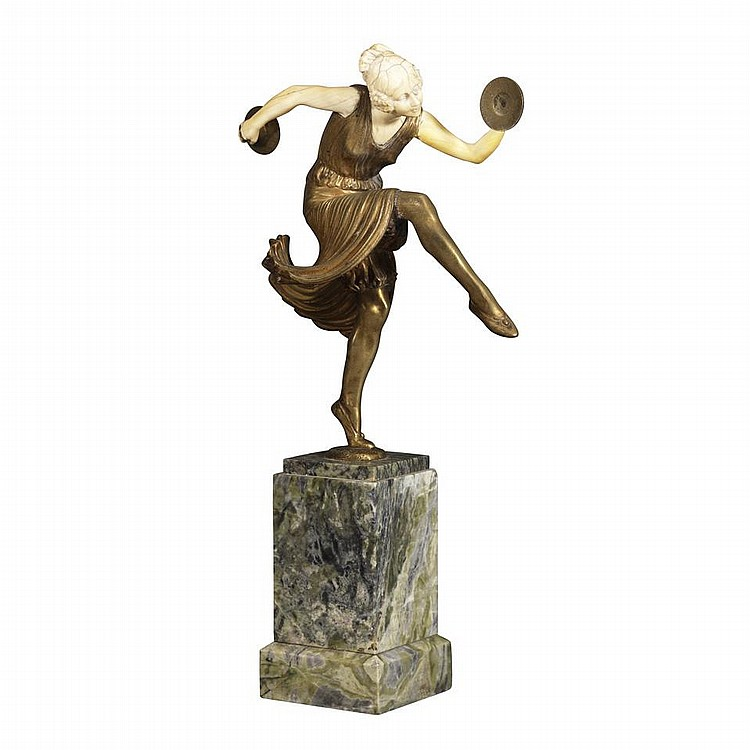 Lucien Charles Edouard Alliot (French, 1867-1967)CYMBAL DANCER, c.1920, gilt bronze and carved ivory figure standing on one foot on stepped marble socle, height 13.2