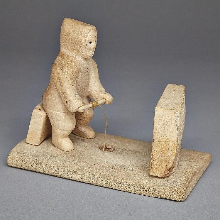 ELISAPEE KANANGNAQ AHLOOLOO (1918-), SEATED MAN FISHING BEHIND A SNOW SCREEN, bone, ivory, 5.25