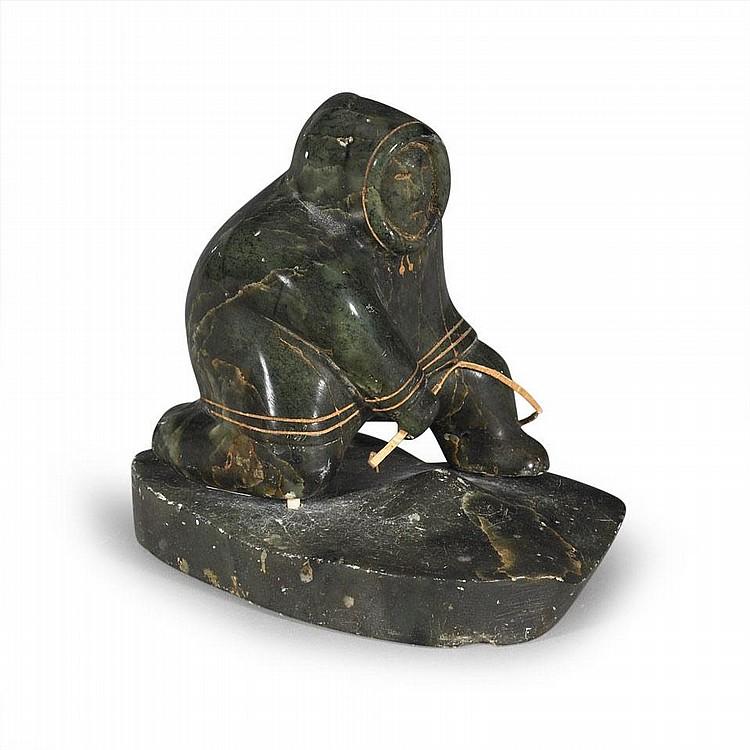 AKEEAKTASHUK (1898-1954), HUNTER PULLING A SEAL, stone, sinew, 3.25