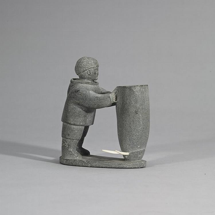 LUCASSIE USAITAIJUK (1897-1962), E9-1173, SalluitHUNTER GUTTING A WALRUS, stone, ivory, signed indistinctly, 6.5