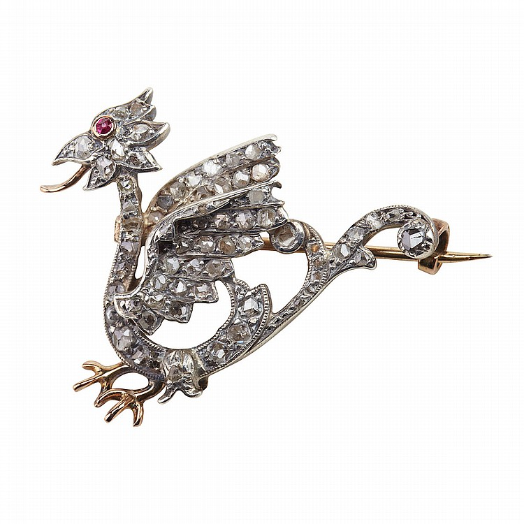 French 18k Yellow Gold And Silver Brooch formed as a Griffin and set with 62 rose cut diamonds and a small ruby eye, 6.8 grams