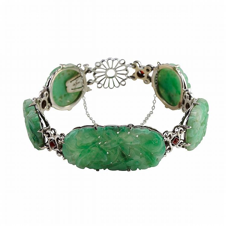 10k White Gold Bracelet set with 5 carved and pierced jadeite panels and small carnelian cabochons, length 7.5