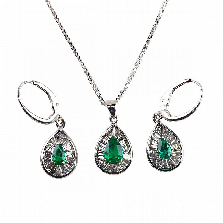 18k White Gold Pendant And Earrings each set with a pear cut emerald (approx. 1.05ct.t.w.) encircled by a total of 55 baguette diamonds (approx. 1.55ct.t.w.), the pendant suspended on an 18k white gold chain, length 18