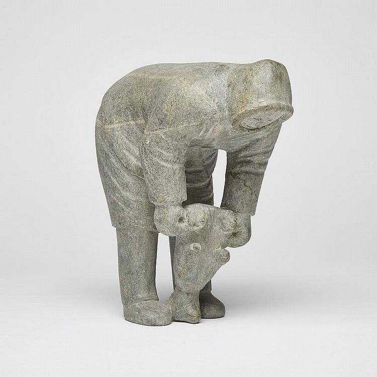 JOSEPIE NINGIOK KUPIRKRUALUK (1930-), MAN SKINNING FOX, stone, 8.5