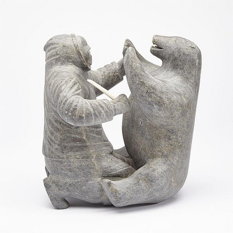 MATUSI UNGNAITOOK (1905-1961), MAN AND BEAR, stone, 9