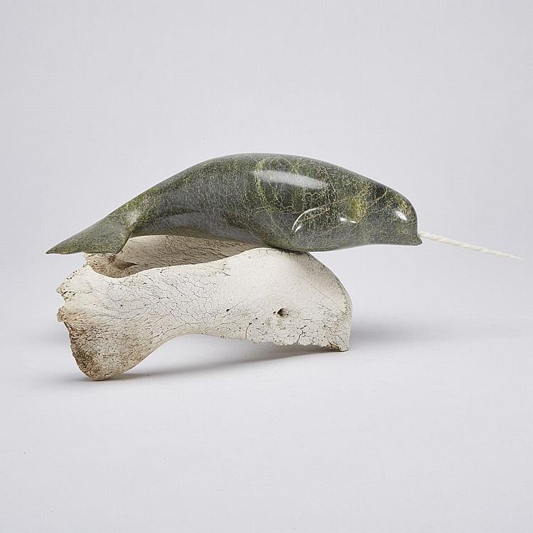 EEGETSUAK PITSEOLAK (1947-), SWIMMING NARWHAL ON BASE, stone, bone, ivory, with/without inset tusk: 5.75