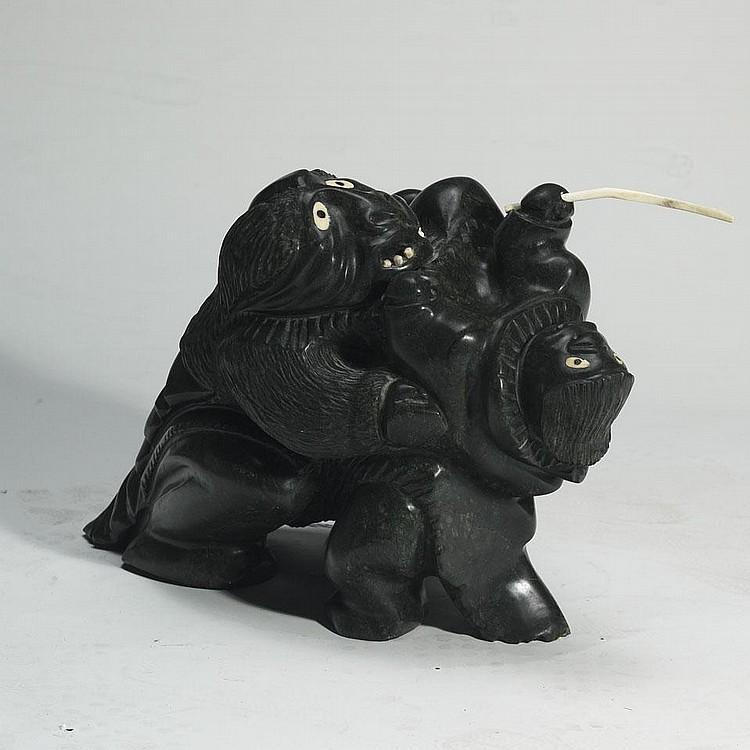 URIASH PUQIQNAK (1946-), E4-556, Gjoa HavenA FIGURE HOLDING ANOTHER