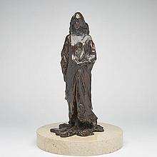 Paul Suttman (1933-1993), STANDING FIGURE #4, 1967, Dark brown patinated bronze; signed, dated '67 and numbered 1/6 in the cast at the bottom edge of her dress. Raised on a circular white stone base., Height of sculpture/Mounted height 16