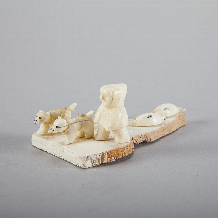 EMILY PANGNERK ILLUITOK (1943-), E3-378, Pelly BayHUNTER WITH TWO DOGS DRAGGING SEALS, ivory, bone, 1.75