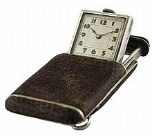 A LEATHER COVERED SOLID SILVER PURSE WATCH CIRCA