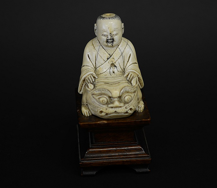 19th Century Chinese Ivory Figure of Child on Tiger