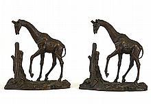 A Pair of Bronze African Giraffe Sculptures