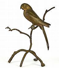A Gilt Metal Perched Parrot
