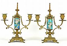 A Pair of Enameled Gilt Iron Candlesticks
