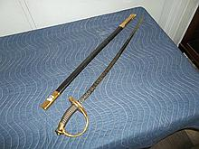 Sword w/leather/metal scarab