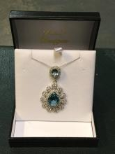 Sterling silver necklace with blue topaz
