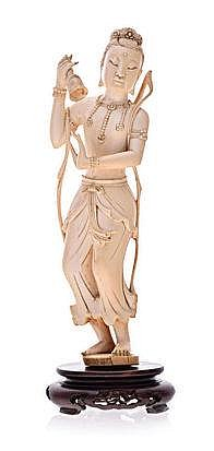 A CARVED IVORY FIGURE OF AN INDIAN DANCER, 19TH CE