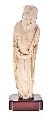 A CHINESE CARVED IVORY FIGURE OF LUXING, MING, 136