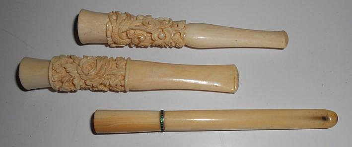 TWO CHINESE CARVED IVORY CIGARETTE HOLDERS, LATE 1
