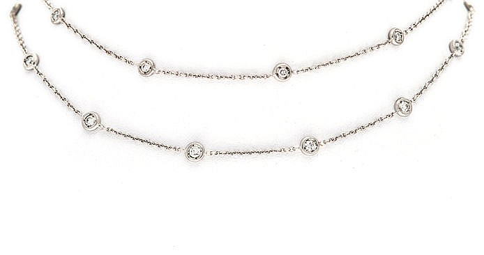 A DIAMOND NECKLACE comprised of a double strand of anchor link chain, inter