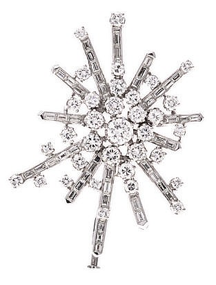 A DIAMOND BROOCH of abstract form, centred with a cluster of round brillian