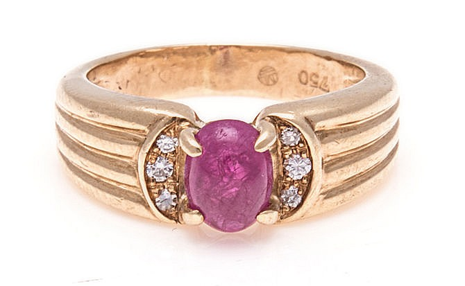 A RUBY RING the tapered fluted band centred with an oval cabochon ruby, fla