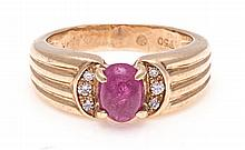 A RUBY RING the tapered fluted band centred with a