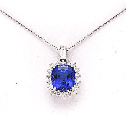 A TANZANITE AND DIAMOND PENDANT centred with a claw-set cushion-cut tanzani
