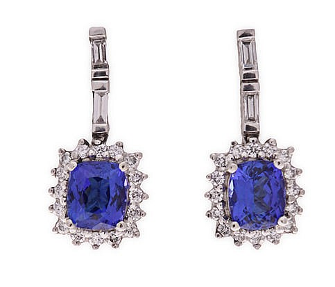A PAIR OF TANZANITE AND DIAMOND PENDANT EARRINGS each surmount set with two