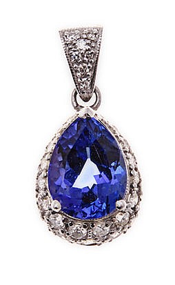 A TANZANITE AND DIAMOND PENDANT centred with a mixed-cut pear-shaped tanzan