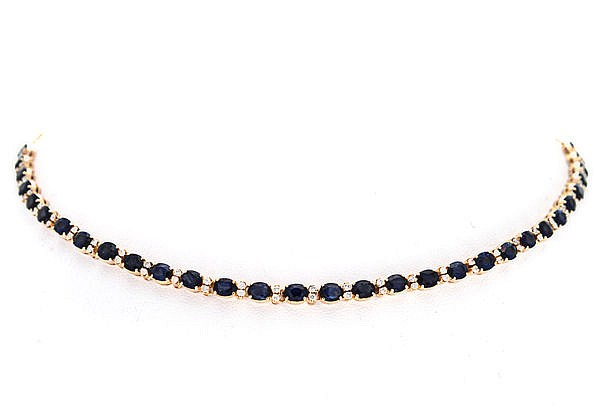 A SAPPHIRE AND DIAMOND NECKLACE designed as an articulated line of oval mix