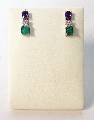 A PAIR OF SAPPHIRE, DIAMOND AND EMERALD PENDANT EARRINGS each surmount claw