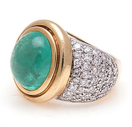 AN EMERALD AND DIAMOND DRESS RING, JENNA CLIFFORD centred with a bezel-set