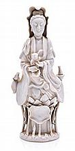 A CHINESE BLANC DE CHINE FIGURE OF GUANYIN AND CHI