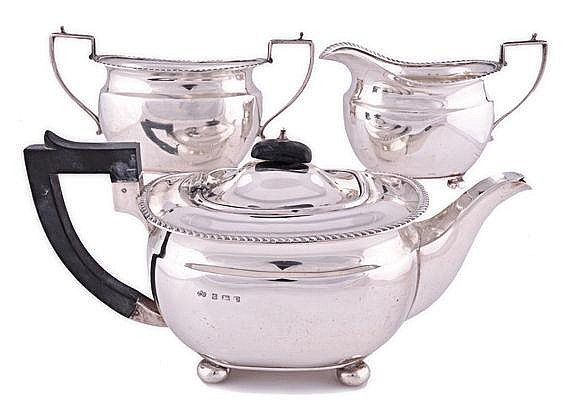 A GEORGE VI SILVER THREE-PIECE TEA SET, ELKINGTON