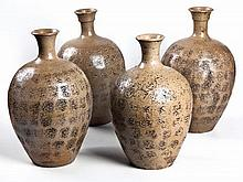 A GROUP OF FOUR CHINESE STONEWARE WATER VESSELS ea