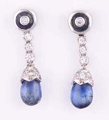 A PAIR OF SAPPHIRE AND DIAMOND PENDANT EARRINGS each surmount centred with