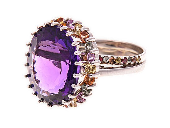 AN AMETHYST AND COLOURED GEM-STONES RING the band comprised of two overlapp