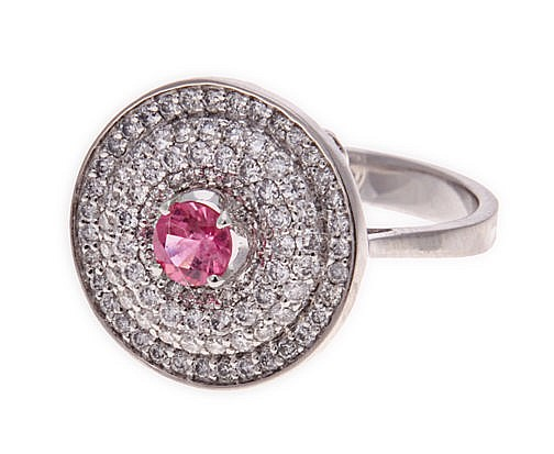 A PINK SAPPHIRE AND DIAMOND RING centred with a circular pink sapphire weig