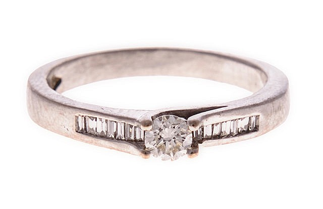 A DIAMOND RING centred with a round brilliant-cut diamond weighing approxim