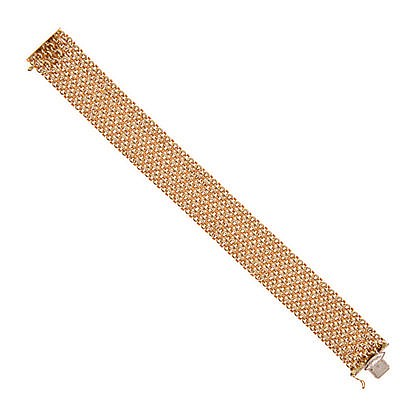 AN 18CT GOLD BRACELET comprised of six rows of cable link chain, with push