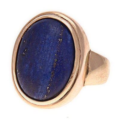 A LAPIS LAZULI RING the plain band centred with a bezel-set oval cabochon l